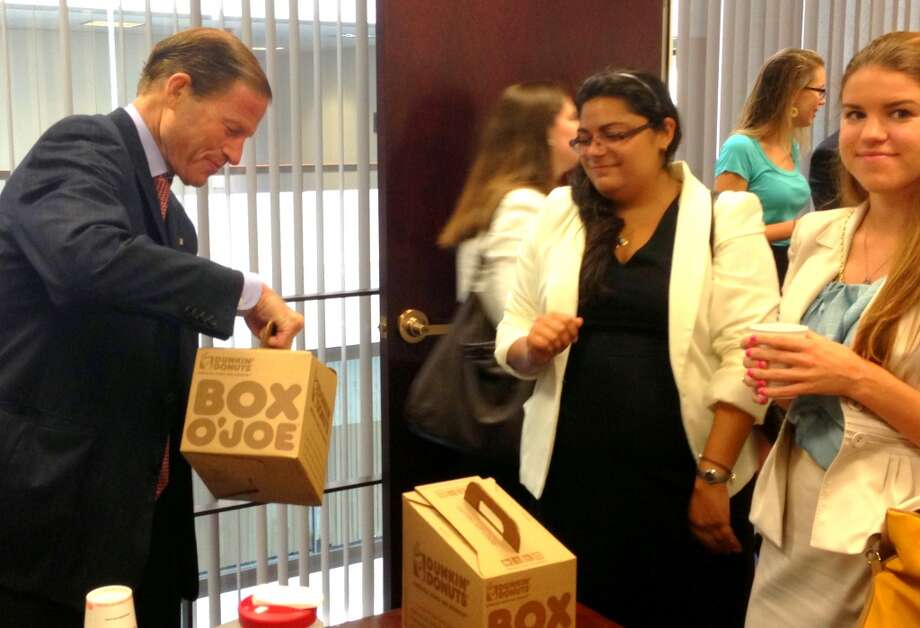 Sen. Richard Blumenthal, D-Conn., serves hot coffee to Claire Jabbour of Danbury an Amy Farina of New Canaan during his inaugural constituent breakfast -- which Senate staff expects to host on a monthly basis -- with Sen. Chris Murphy, D-Conn., in his Washington, D.C. office Wednesday. About 30 constituents gathered to meet both senators and discuss policy issues impacting them.