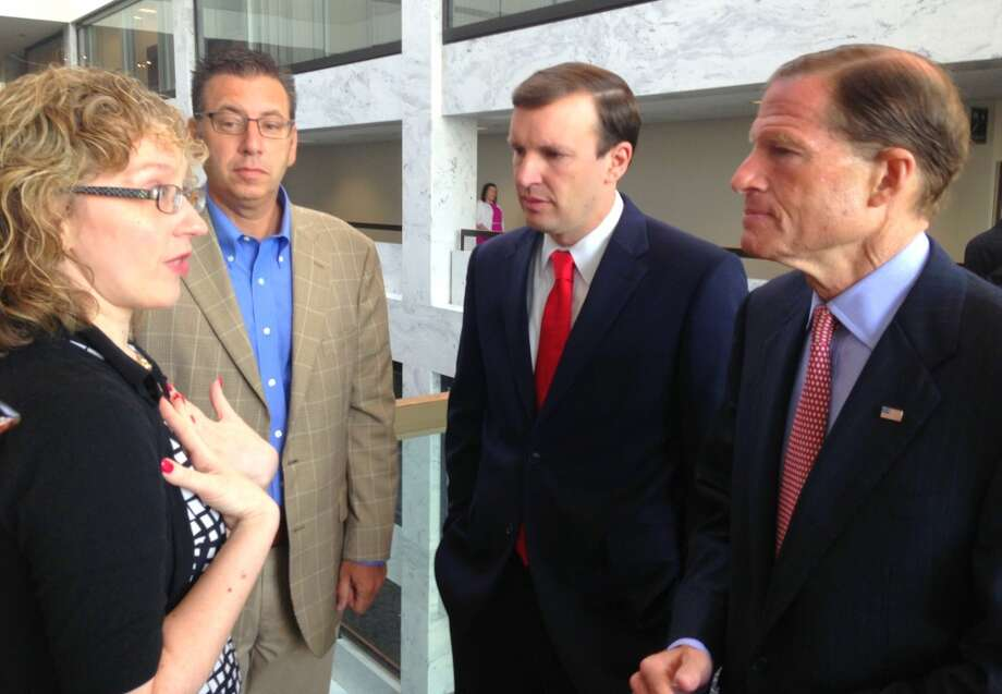 Joan Nicoll-Senft, an associate professor at Central Connecticut State University in New Britain, discusses special education needs with Sens. Richard Blumenthal, D-Conn., and Chris Murphy, D-Conn., during their inaugural constituent coffee in the Hart Senate office building in Washington, D.C., Wednesday. Senate staff anticipates hosting coffees on a monthly basis.