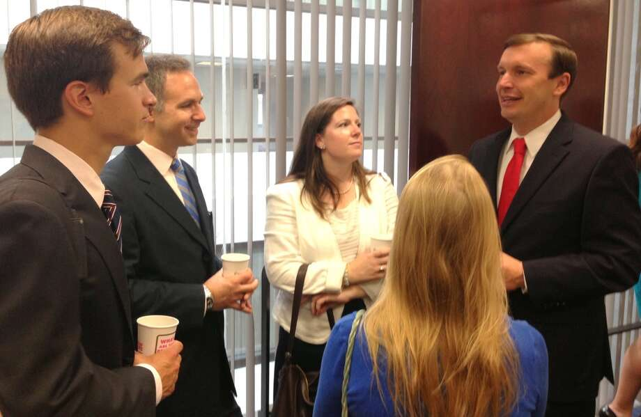 Sen. Chris Murphy, D-Conn., mingles with constituents Wednesday morning in the Washington, D.C. office of Sen. Richard Blumenthal, D-Conn., during their inaugural constituent coffee, which Senate staff anticipates holding on a monthly basis. About 30 constituents gathered to meet both senators and discuss policy issues impacting them.