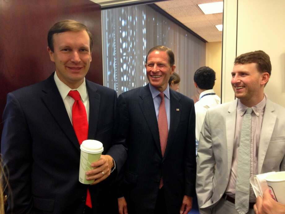 Sens. Chris Murphy, D-Conn., and Richard Blumenthal, D-Conn., with constituent Noah Morgenstein of Wallingford Wednesday morning during their inaugural constituent coffee in the Hart Senate office building in Washington, D.C. About 30 constituents gathered to meet both senators and discuss policy issues impacting them. Senate staff anticipates hosting constituent coffees on a monthly basis.
