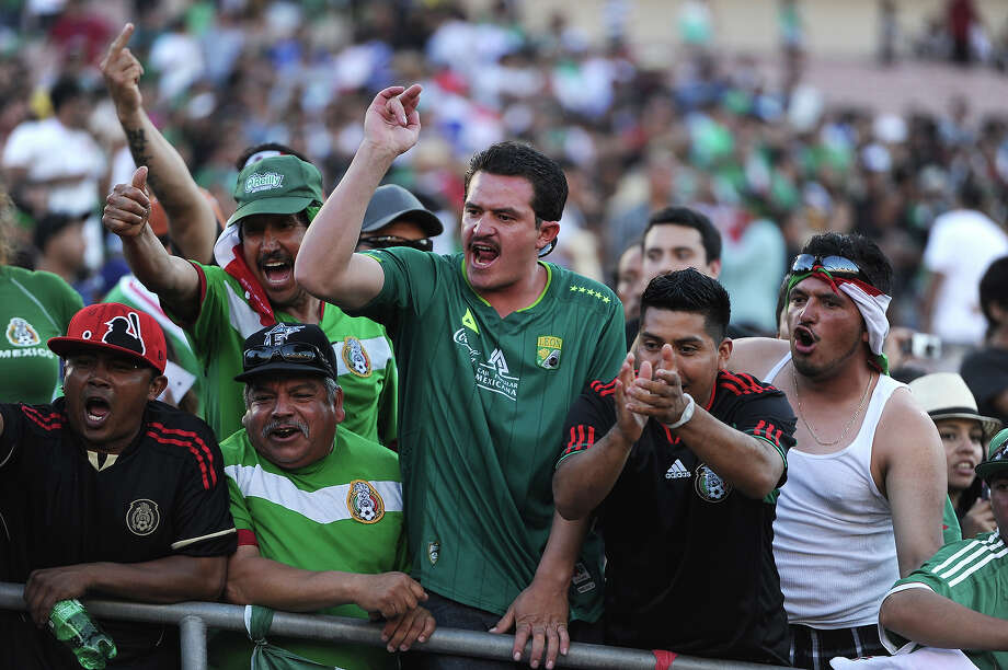 Mexico fans react during the Mexico vs Panama 2013 CONCACAF Gold Cup Opener, July 7, 2013 at the Rose Bowl in Pasadena, California.  Panama defeated Mexico 2-1. Photo: ROBYN BECK, AFP/Getty Images / 2013 AFP