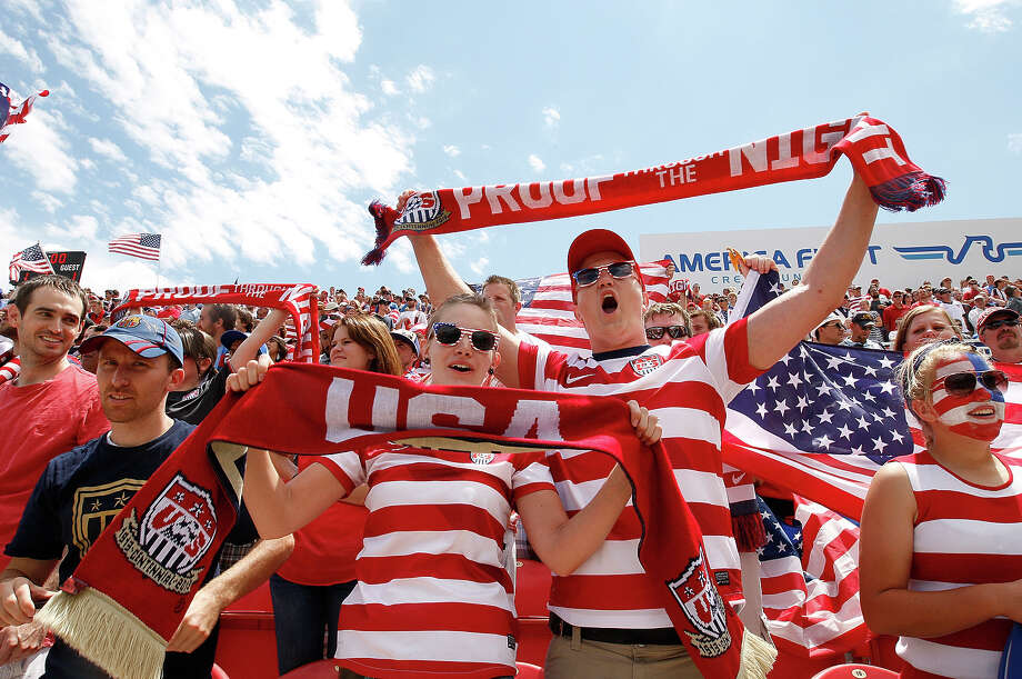 Fans of the United States cheer during a game against Cuba during the first half of a CONCACAF Gold Cup match July 13, 2013 at Rio Tinto Stadium in Sandy, Utah. The U.S. defeated Cuba 4-1. Photo: George Frey, Getty Images / 2013 Getty Images