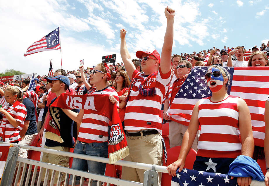 Fans of the United States cheer during a game against Cuba in the first half of a CONCACAF Gold Cup match July 13, 2013 at Rio Tinto Stadium in Sandy, Utah. The U.S. defeated Cuba 4-1. Photo: George Frey, Getty Images / 2013 Getty Images