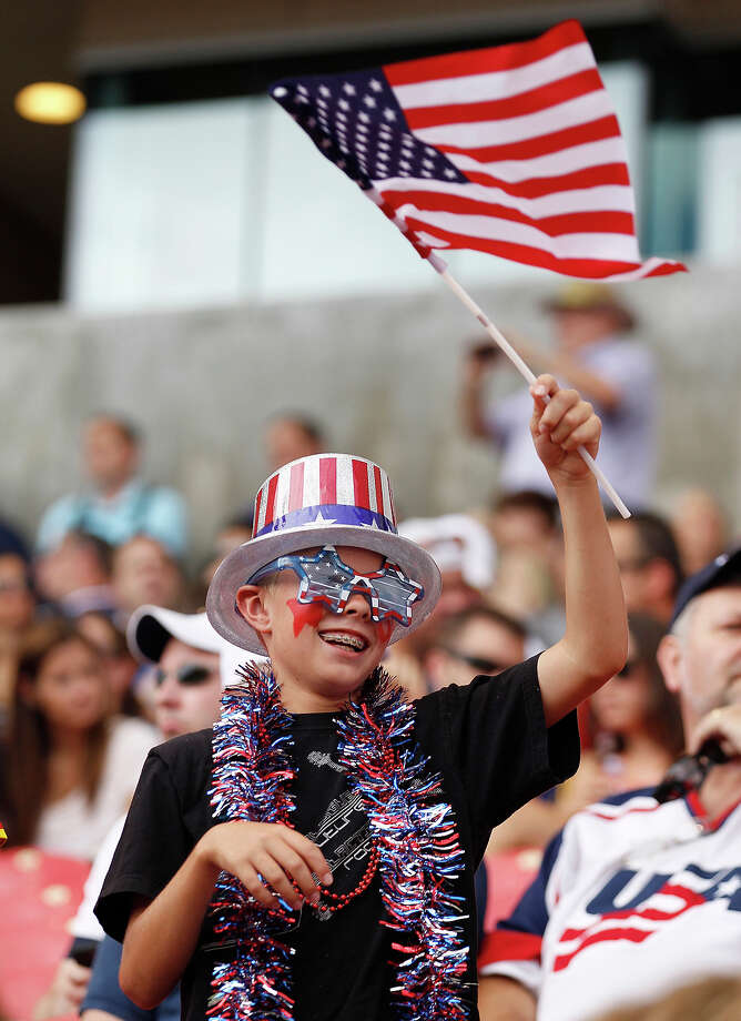 A fan of the United States cheers during a game against Cuba during the first half of a CONCACAF Gold Cup match July 13, 2013 at Rio Tinto Stadium in Sandy, Utah. The U.S. defeated Cuba 4-1. Photo: George Frey, Getty Images / 2013 Getty Images