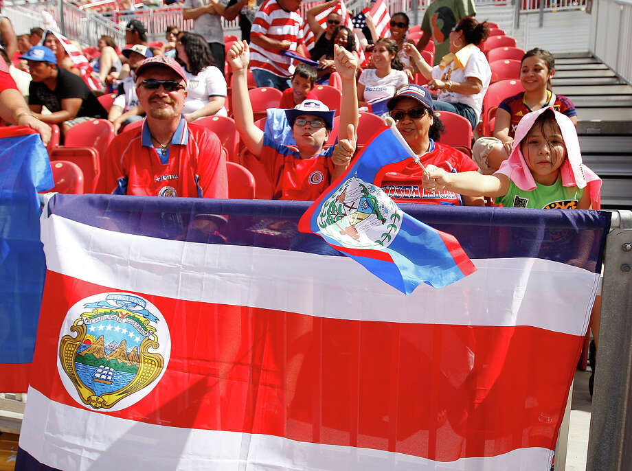 Fans of Costa Rica cheer during a game against Belize during the first half of a CONCACAF Gold Cup match July 13, 2013 at Rio Tinto Stadium in Sandy, Utah. Costa Rica defeated Belize 1-0. Photo: George Frey, Getty Images / 2013 Getty Images