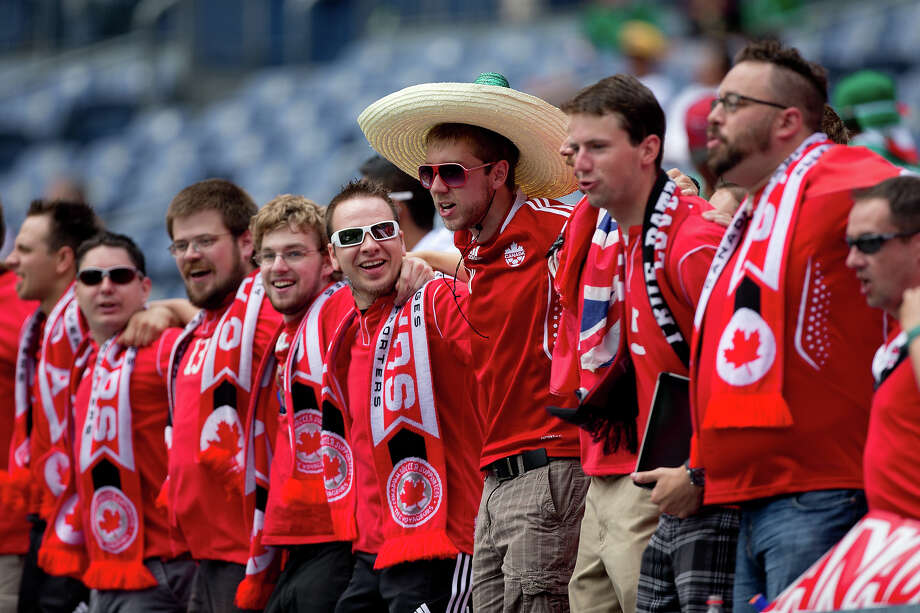 Supporters of team Canada cheer on their squad during the first half of a CONCACAF Gold Cup match against Panama at Sports Authority Field at Mile High on July 14, 2013 in Denver, Colorado. Photo: Justin Edmonds, Getty Images / 2013 Getty Images