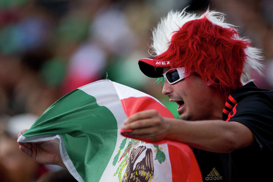 A Mexico fan supports his team during the first half of a CONCACAF Gold Cup match against Martinique at Sports Authority Field at Mile High on July 14, 2013 in Denver, Colorado. Photo: Justin Edmonds, Getty Images / 2013 Getty Images