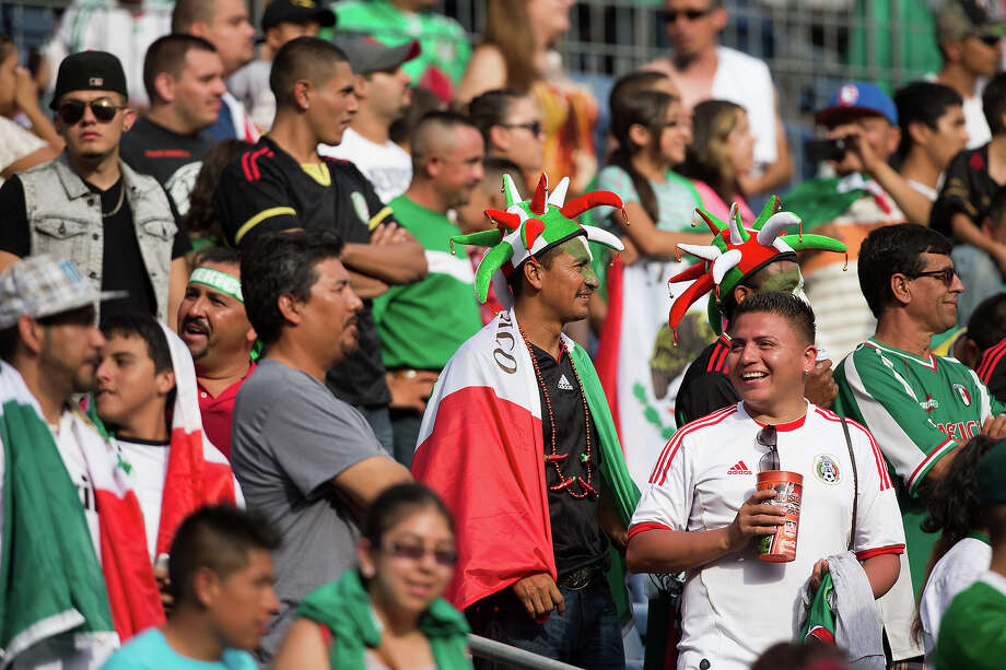 Mexico fans support their team against Martinique during a CONCACAF Gold Cup match at Sports Authority Field at Mile High on July 14, 2013 in Denver, Colorado. Photo: Justin Edmonds, Getty Images / 2013 Getty Images