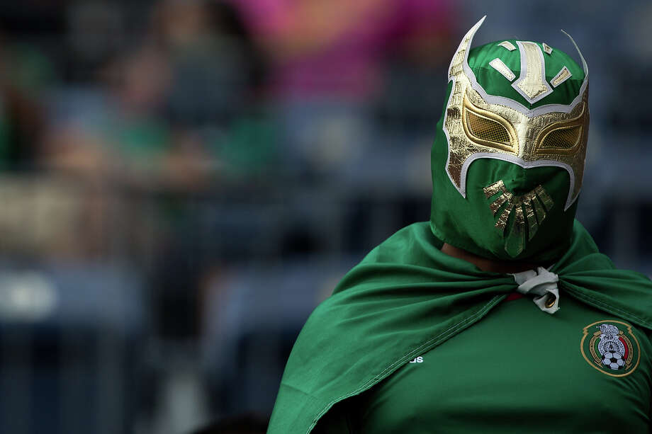 A fan wears a lucha libre mask to support Mexicao against Martinique during the second half of a CONCACAF Gold Cup match at Sports Authority Field at Mile High on July 14, 2013 in Denver, Colorado. Photo: Justin Edmonds, Getty Images / 2013 Getty Images