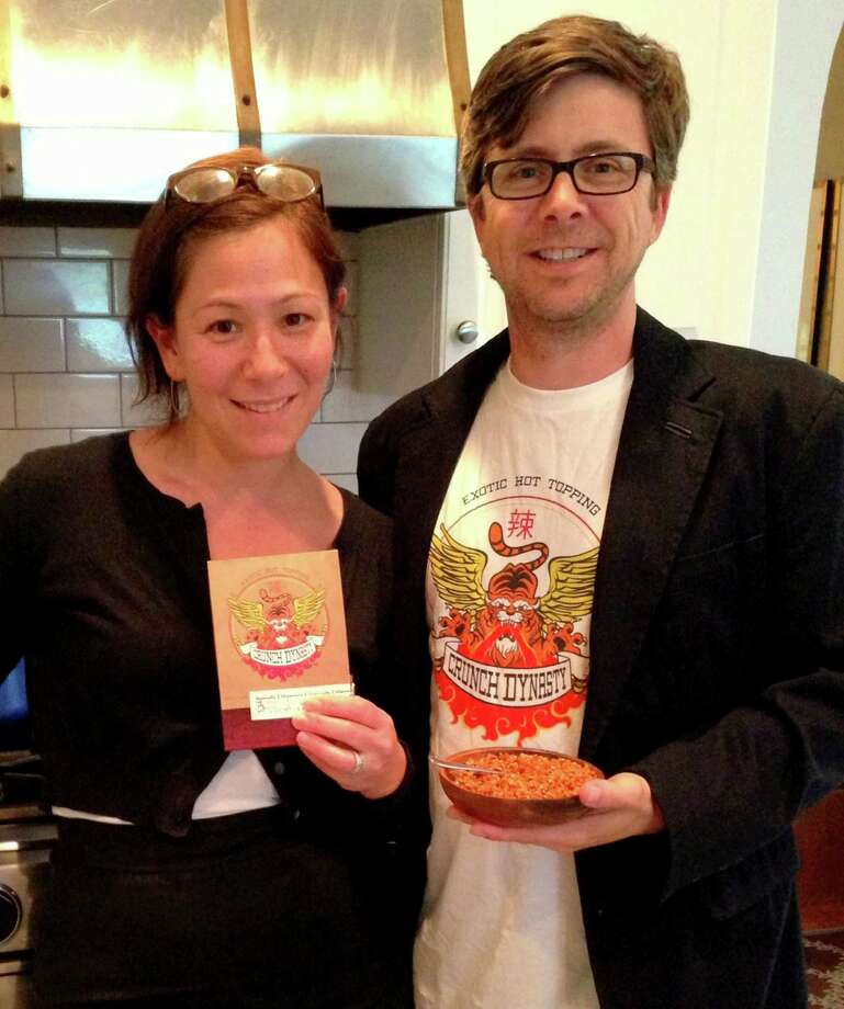"Greenwich native Anya Block Mills, left, and her husband John Mills have taken her mother's secret family recipe for ""hot sauce,""  spun a legend around it, and are selling the spicy product under the name Crunch Dynasty. Photo: Contributed Photo"