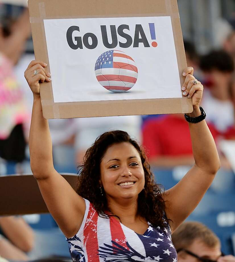 A US fan cheer holds a sign before the 2013 CONCACAF Gold Cup match against Costa Rica July 16, 2013 at Rentschler Field in Hartford, Connecticut. Photo: Stan Honda, AFP/Getty Images