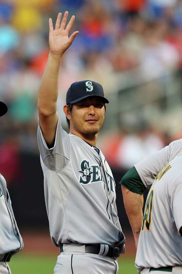 American League All-Star Hisashi Iwakuma, of the Seattle Mariners, waves during the 84th MLB All-Star Game on July 16, 2013, at Citi Field in Queens, N.Y. Photo: Mike Ehrmann, Getty Images / 2013 Getty Images