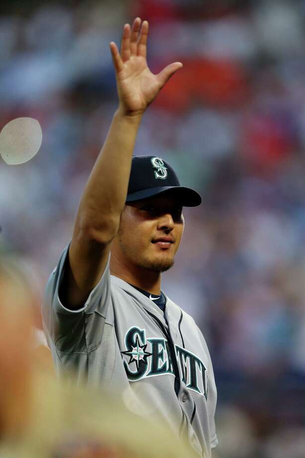American League All-Star Hisashi Iwakuma, of the Seattle Mariners, waves during the 84th MLB All-Star Game on July 16, 2013 at Citi Field in Queens, N.Y. Photo: Mike Ehrmann, Getty Images / 2013 Getty Images