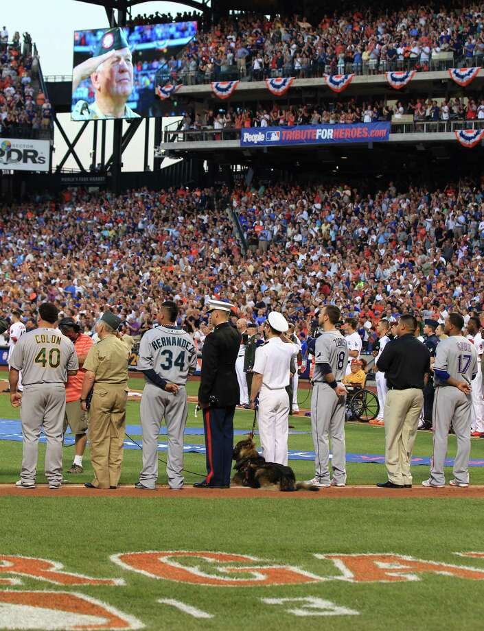 Players line up with finalists from the People Tribute for Heroes campaign in a pregame ceremony for the 84th MLB All-Star Game at Citi Field on Tuesday, July 16, 2013, in Queens, N.Y. Photo: Tim Clayton, MLB Photos Via Getty Images / 2013 Major League Baseball Photos