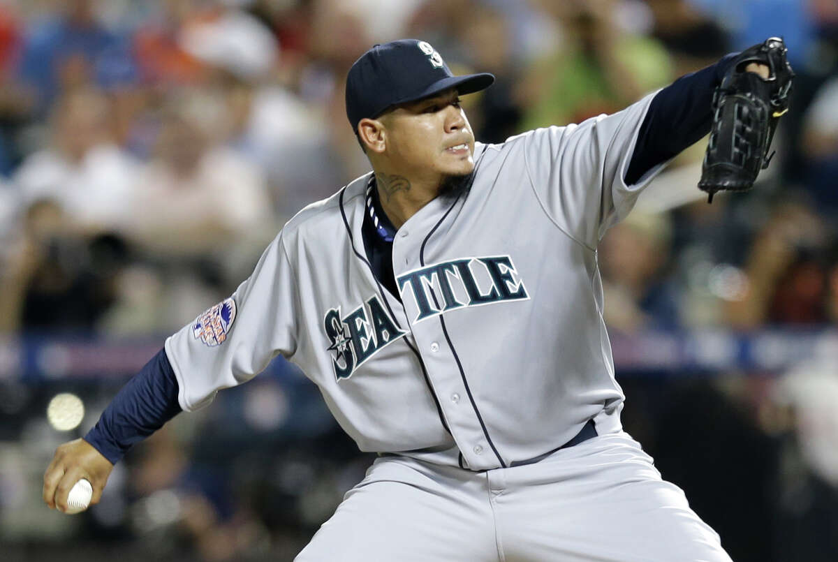 The American League's Felix Hernandez, of the Seattle Mariners, pitches during the fourth inning of the MLB All-Star Game on July 16, 2013, in New York.