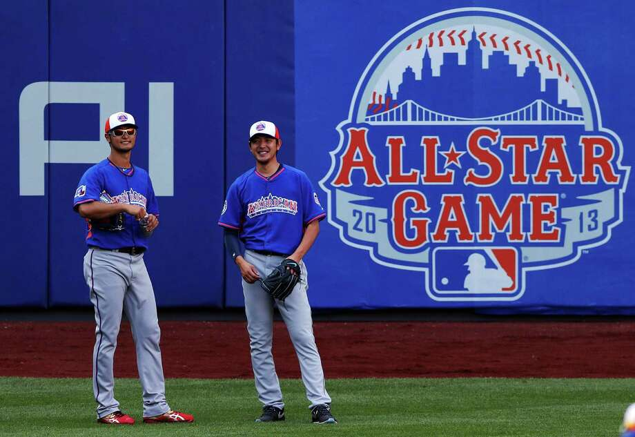 American League All-Stars Yu Darvish, of the Texas Rangers, and American League All-Star Hisashi Iwakuma, of the Seattle Mariners, shag fly balls in the outfield before the 84th MLB All-Star Game on July 16, 2013 at Citi Field in Queens, N.Y. Photo: Bruce Bennett, Getty Images / 2013 Getty Images