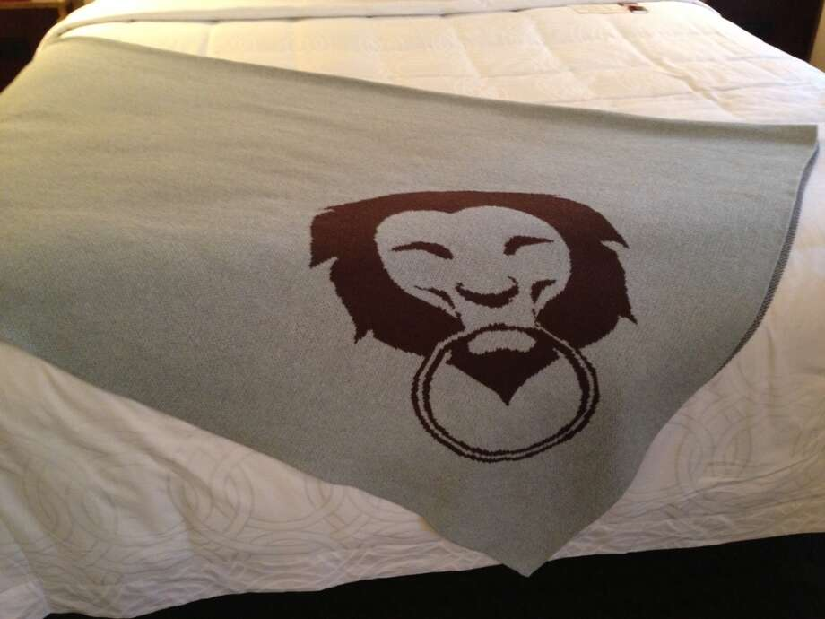 Custom blankets sport a lion in the logo.
