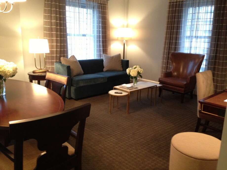 The table and seating areas are part of the suite.
