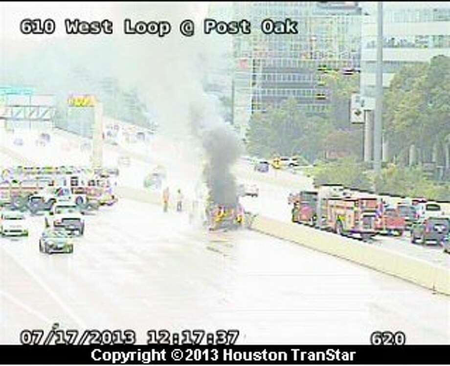 A car fire slowed traffic on the southbound West Loop near Post Oak about noon Wednesday. Photo: Houston Transtar
