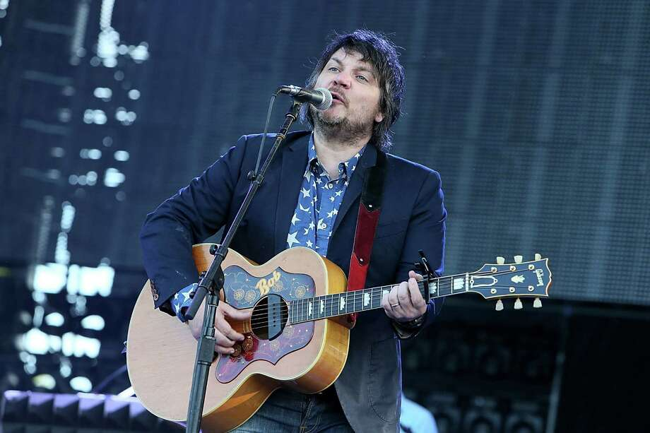 Jeff Tweedy of Wilco performs during the 2013 Bonnaroo Music & Arts Festival on June 14, 2013, in Manchester, Tennessee. The members of Wilco, Bob Dylan, My Morning Jacket and Ryan Bingham are set to make a stop in Connecticut at Bridgeport's Webster Bank Arena on Friday, July 19, 2013, as part of this summer's Americanarama Festival of Music. (Photo by Gary Miller/WireImage) Photo: Contributed Photo / Stamford Advocate Contributed