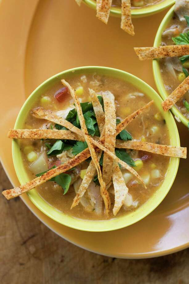 Southwestern corn and chicken chowder with tortilla crisps can be an easy weeknight meal by utilizing shortcuts. (AP Photo/Matthew Mead) ORG XMIT: MER2013071510533591 Photo: Matthew Mead / FR170582