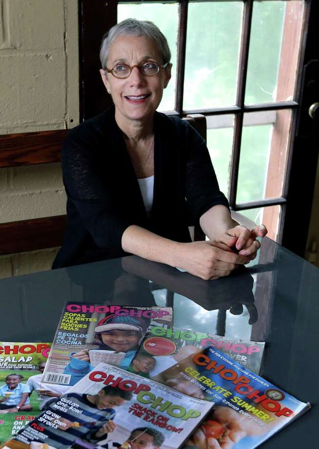"In this Thursday, June 27, 2013 photo, President and founder Sally Sampson poses in the conference room at the offices of ChopChop Magazine in Watertown, Mass.  Sampson never set out to be the editor of an award-winning cooking magazine for kids. But about five years ago, the prolific cookbook author read a newspaper article that changed her life, her career and her mission. ""It was like I was reading for the first time about somebody who cared about what I cared about,"" Sampson said. (AP Photo/Elise Amendola)  ORG XMIT: MER2013071113441651 Photo: Elise Amendola / AP"