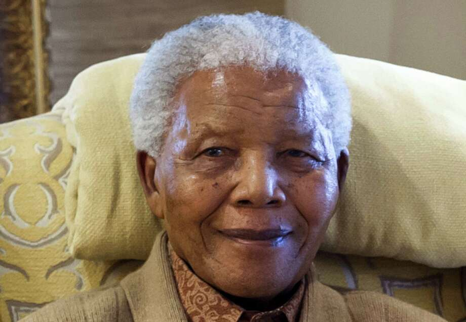 "(FILES) This picture taken on July 17, 2012 shows former South African President Nelson Mandela during a visit by former US president at his home in Qunu, Eastern Cape, on the eve of his 94th birthday. Global celebrations and charity events will mark Nelson Mandela's 95th birthday on July 18, 2013 but the critically ill anti-apartheid hero himself may still be confined to his Pretoria hospital bed on life-support.  = RESTRICTED TO EDITORIAL USE - MANDATORY CREDIT ""AFP PHOTO - CLINTON FOUNDATION / BARBARA KINNEY""- NO MARKETING NO ADVERTISING CAMPAIGNS - DISTRIBUTED AS A SERVICE TO CLIENTS =BARBARA KINNEY/AFP/Getty Images Photo: BARBARA KINNEY / AFP"