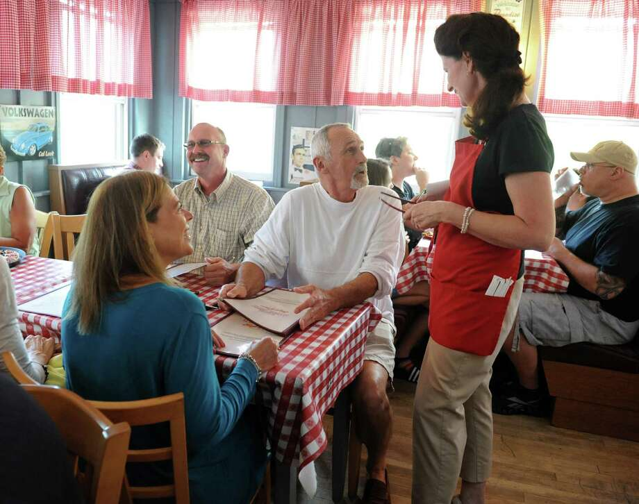 From left, Andrea Hill, of Troy, Mike O'Connor of Saratoga Lake and Richard Hill of Troy joke around with waitress Suzie Kelly as she takes their order at Kay's Pizza on Thursday, July 11, 2013 in Averill Park, N.Y. (Lori Van Buren / Times Union) Photo: Lori Van Buren / 10023125A