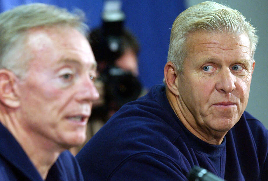 Cowboys owner Jerry Jones answers questions from the media as new Cowboys head coach Bill Parcells looks on Friday July 25, 2003 at the Alamodome. PHOTO BY EDWARD A. ORNELAS/STAFF Photo: EDWARD A. ORNELAS, SAN ANTONIO EXPRESS-NEWS / SAN ANTONIO EXPRESS-NEWS