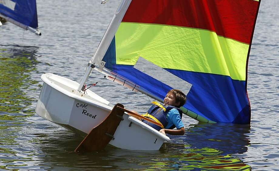 Going overboard to learn how to sail: Nine-year-old Aidan Stickney intentionally capsizes his boat at Eckerd College's Summer Watersports Camp in St. Petersburg, Fla. Photo: James Borchuck, Associated Press