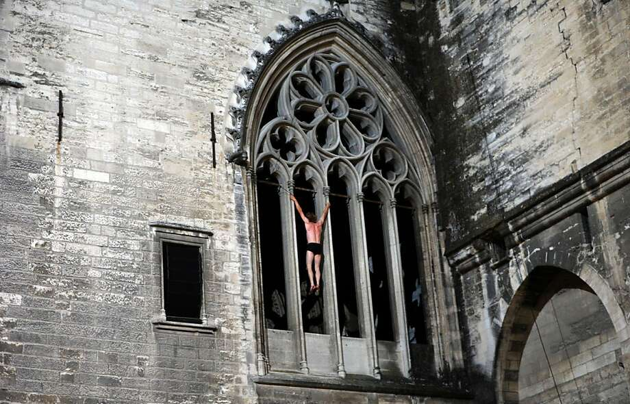 "The 'Cour' de France: French climber Antoine Le Menestrel performs a scene from the Avignon Theatre Festival entry ""Cour d'honneur"" at the Cour d'honneur du Palais des Papes in Avignon. Cour d'honneur is the forecourt of a building, especially a monumental forecourt. Photo: Anne-Christine Poujoulat, AFP/Getty Images"