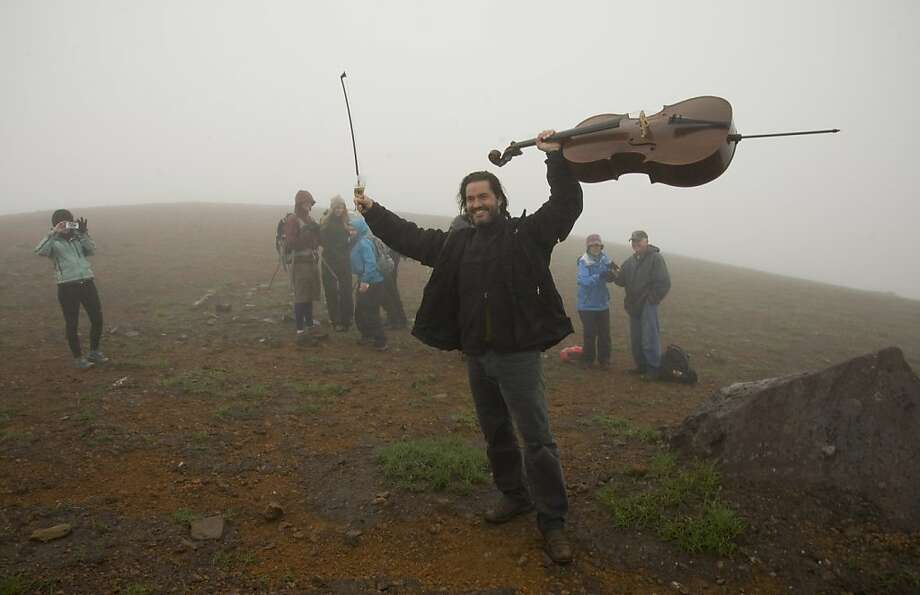 There's always room for cello - even on the rim of a volcano. Cellist Zuill Bailey takes a bow after performing on top of 3,200-foot Mt. Edgecumbe, a dormant volcano in Sitka, Alaska. Bailey carried his carbon-fiber cello up the seven-mile trail to play a short concert. Photo: James Poulson, Associated Press