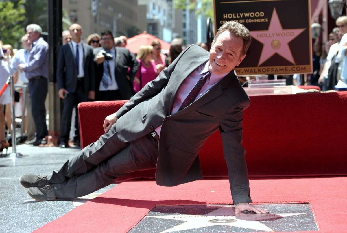 Bryan Cranston poses on his new star on the Hollywood Walk of Fame on Tuesday, July 16, 2013 in Los Angeles. (Photo by John Shearer/Invision for AMC/AP Images)