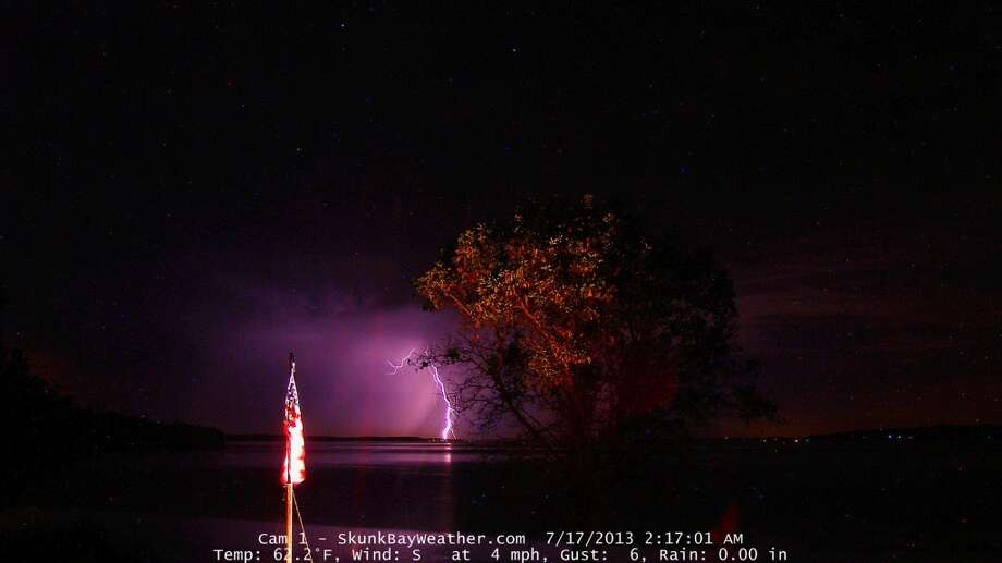 Lightning strike captured by Greg Johnson at his home-based weather station in Hansville called Skunk Bay Weather.