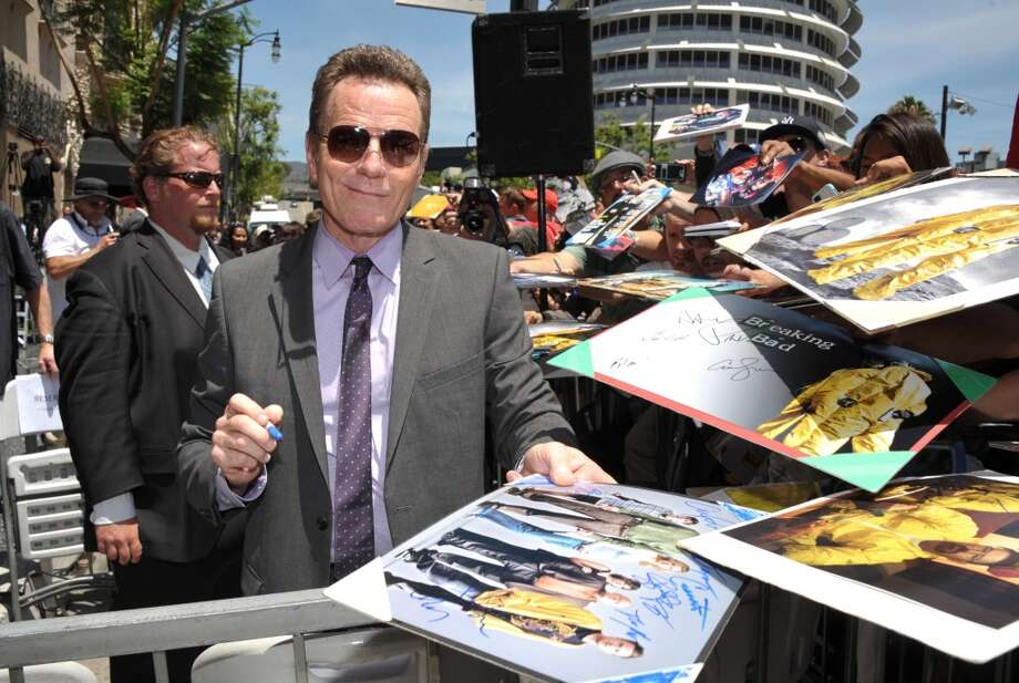 Bryan Cranston signs autographs after receiving a star on the Hollywood Walk of Fame on Tuesday, July 16, 2013 in Los Angeles. (Photo by John Shearer/Invision for AMC/AP Images)
