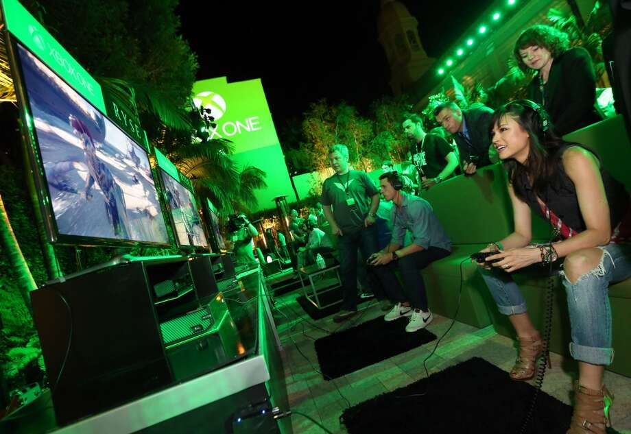 "Lisa Malambri plays the ""Ryse"" demo at the Xbox One Showcase event at the Vibiana in Los Angeles on June 10th, 2013."