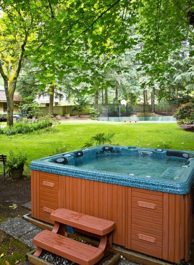 Hot tub of 13220 N.E. 24th St., in Bellevue. Photo: Courtesy Tere Foster And Moya Skillman, Windermere Real Estate
