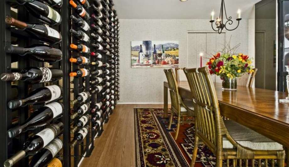 Wine wall of 13220 N.E. 24th St., in Bellevue. Photo: Courtesy Tere Foster And Moya Skillman, Windermere Real Estate