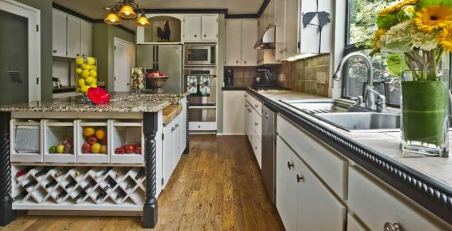 Kitchen of 13220 N.E. 24th St., in Bellevue. Photo: Courtesy Tere Foster And Moya Skillman, Windermere Real Estate