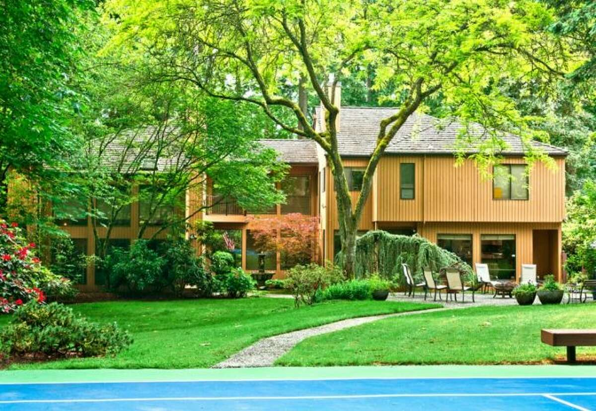 Want to reconnect with the Seattle SuperSonics' glory days? You can live like legendary coach Lenny Wilkens in this house, 13220 N.E. 24th St., in Bellevue. Wilkens had the house custom-built in 1978, a year before the Sonics won their sole championship. The 5,311-square-foot house has five bedrooms, 4.75 bathrooms, four fireplaces, walls of windows, a wine wall in the dining room, a wet bar, a family room and a den on a 0.8-acre lot with a hot tub, a fountain, a patio and a tennis court. It's listed for $1.398 million.