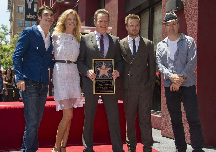 "Bryan Cranston, (C), star of the television series ""Breaking Bad,"" poses with fellow cast members, left to right, RJ Mitte, Anna Gunn, Aaron Paul and Bob Odenkirk after Cranston received a star on the Hollywood Walk of Fame , July 16, 2013 in Hollywood, California.  AFP PHOTO / ROBYN BECKROBYN BECK/AFP/Getty Images"