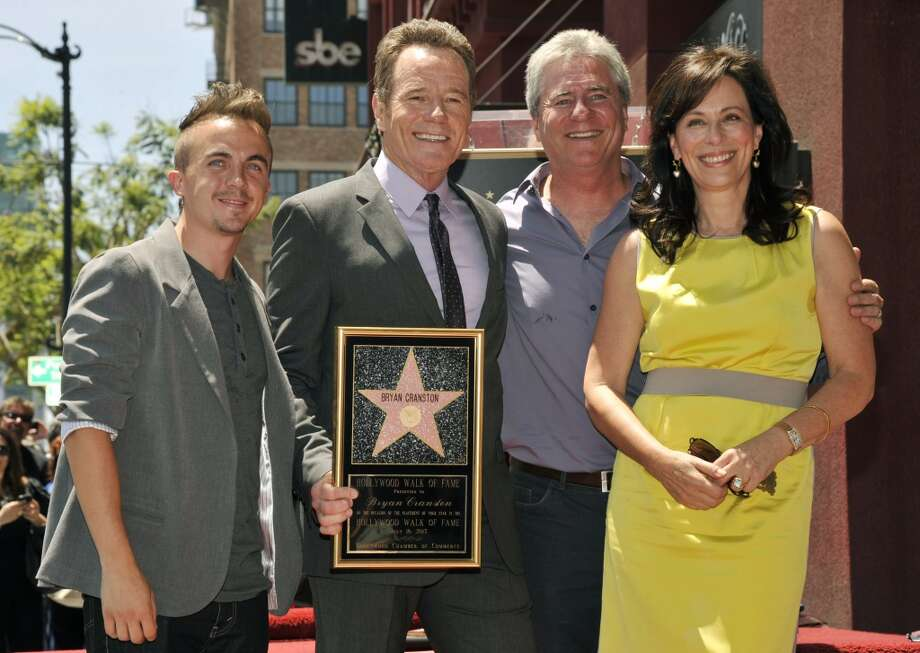 "Actor Bryan Cranston, second from left, a cast member in the television series ""Malcolm in the MIddle,"" poses with fellow cast members Frankie Muniz, left, and Jane Kaczmarek, far right, and the show's creator Linwood Boomer after Cranston received a star on the Hollywood Walk of Fame on Tuesday, July 16, 2013 in Los Angeles. (Photo by Chris Pizzello/Invision/AP)"