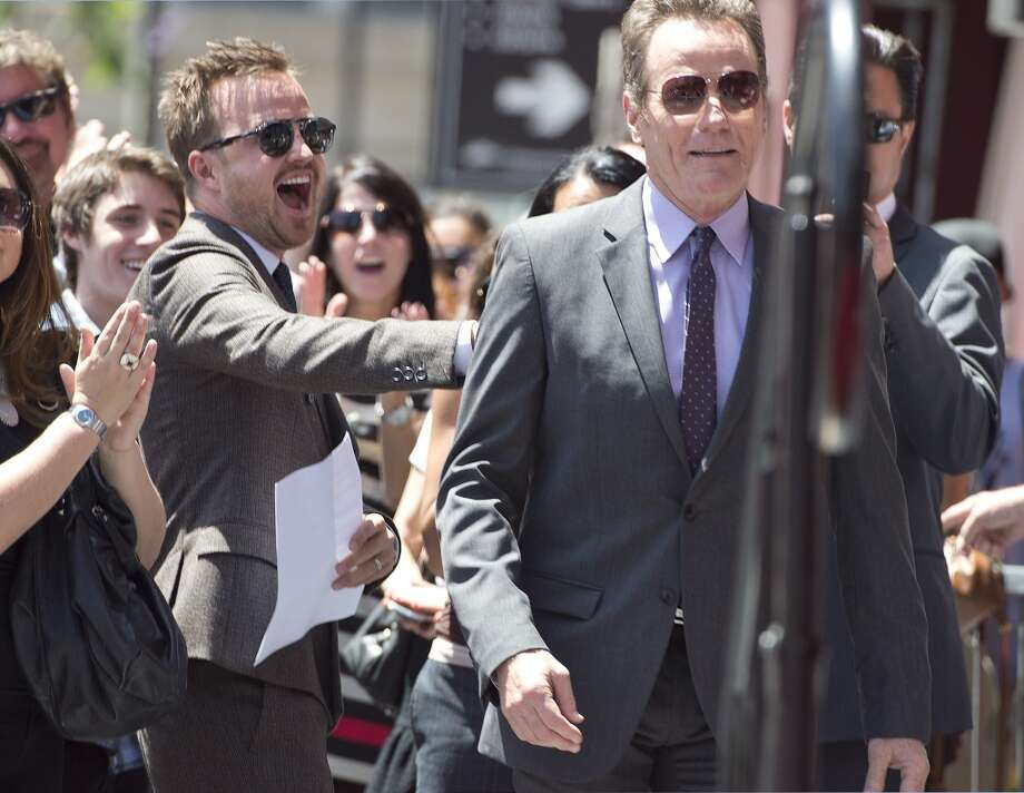 "Bryan Cranston (R), star of the television series ""Breaking Bad,"" gets a pat on the back from co-star Aaron Paul (L) at Cranston's star ceremony on the Hollywood Walk of Fame , July 16, 2013 in Hollywood, California.  AFP PHOTO / ROBYN BECKROBYN BECK/AFP/Getty Images"