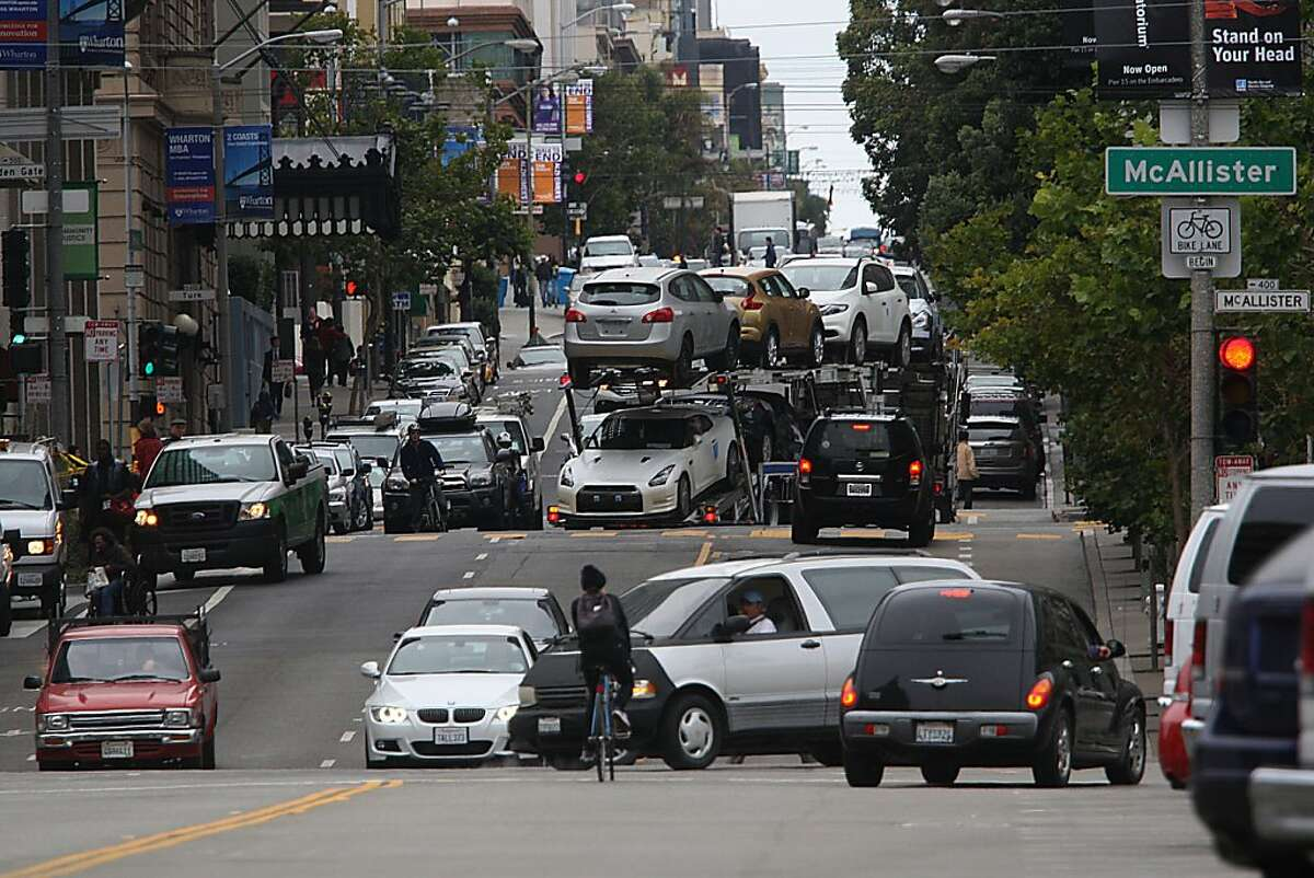 A view of traffic on Polk St. at Golden Gate Ave. during morning commute hours in San Francisco, Calif., on Wednesday, July 17, 2013.