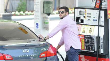 """Michael Strazza of Greenwich pumps gas at the Shell station at 1429 E. Putnam Ave. in Old Greenwich, Wednesday, July 17, 2013. Strazza called the plus $4 per gallon gas """"ridiculous!"""" The prices at the station range from $4.15 to $4.49 per gallon."""