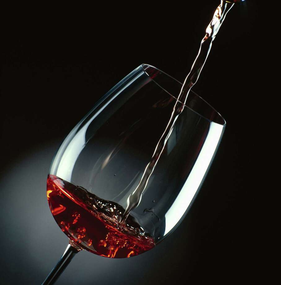 Your average five-ounce glass of red wine is about 125 calories and is just about equal to ... Photo: Stockbyte