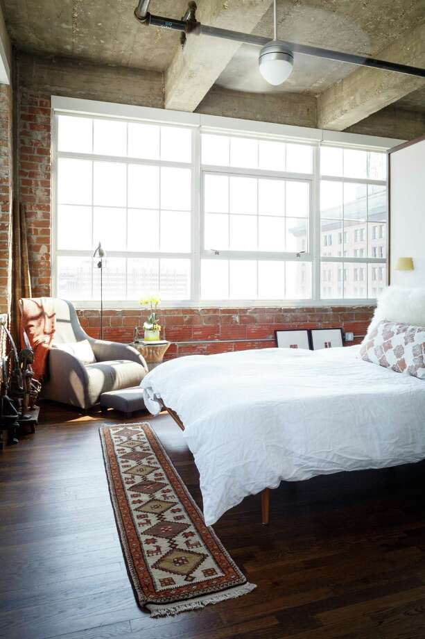 The bedroom in Terry Demchak's condo in the Hermann Lofts. Photo: Michael Paulsen, Staff / © 2013 Houston Chronicle