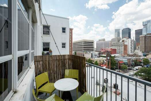 It was the 180-degree views that sold Teresa Demchak on her seventh-floor apartment in the Hermann Lofts building downtown. Here's a look at the outdoor balcony. Photo: Michael Paulsen, Staff / © 2013 Houston Chronicle
