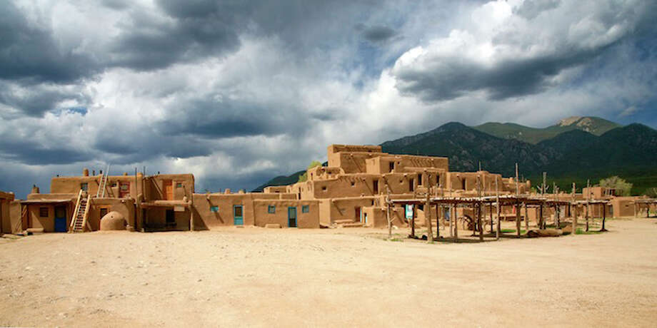 Taos Pueblo is the only living Native American community to be designated both a World Heritage Site by UNESCO and a National Historic Landmark. Visit www.taospueblo.com for details. Photo: Lenny Foster / Taos