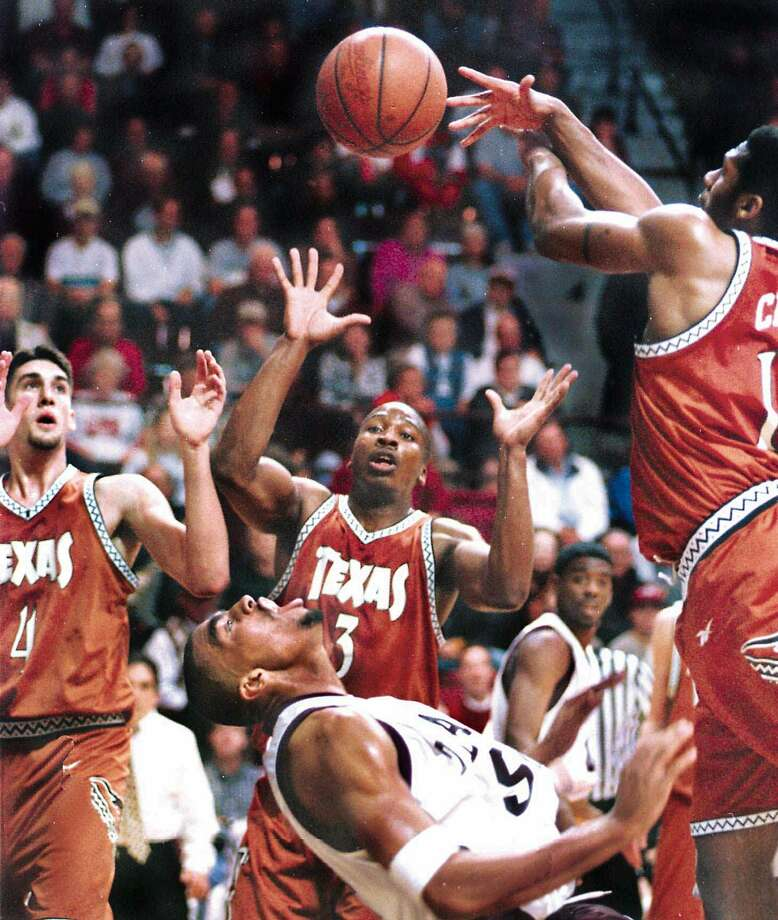 Texas A&M's Larry Thompson looks up at the ball as it flies away to a trio of Texas players, including Chris Mihm (4), Gabe Muoneke (3) and Kris Clack during the first half at G. Rollie White Coliseum in 1998. Photo: DAVE MCDERMAND, MBR / BRYAN-COLLEGE STATION EAGLE